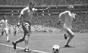 England captain Bobby Moore gets ready to block Jairzinho's cross.