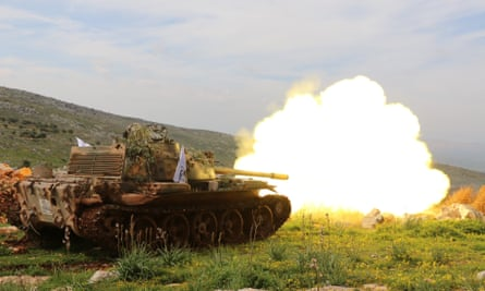 A Turkih tank fires during an operation near Afrin, Syria, on Monday.