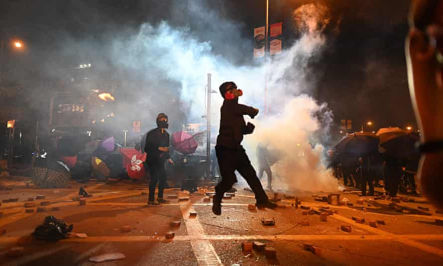 A protester throws a petrol bomb during clashes with police outside the Polytechnic University of Hong Kong last year.