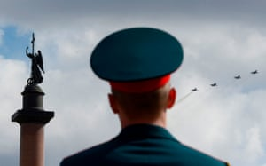 Military aircraft fly over Dvortsovaya Square in Saint Petersburg