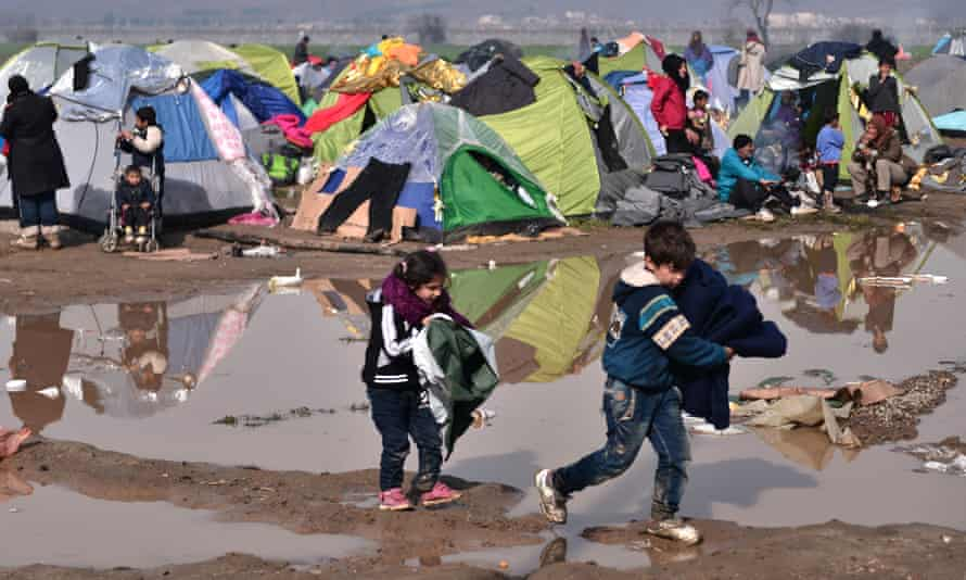 Child refugees in a camp at the Greek Macedonian borders last year … former child refugee Alfred Dubs called the government's move 'shabby'.