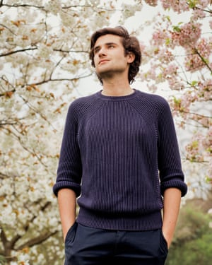 Alexander Hoyle by a tree in blossom