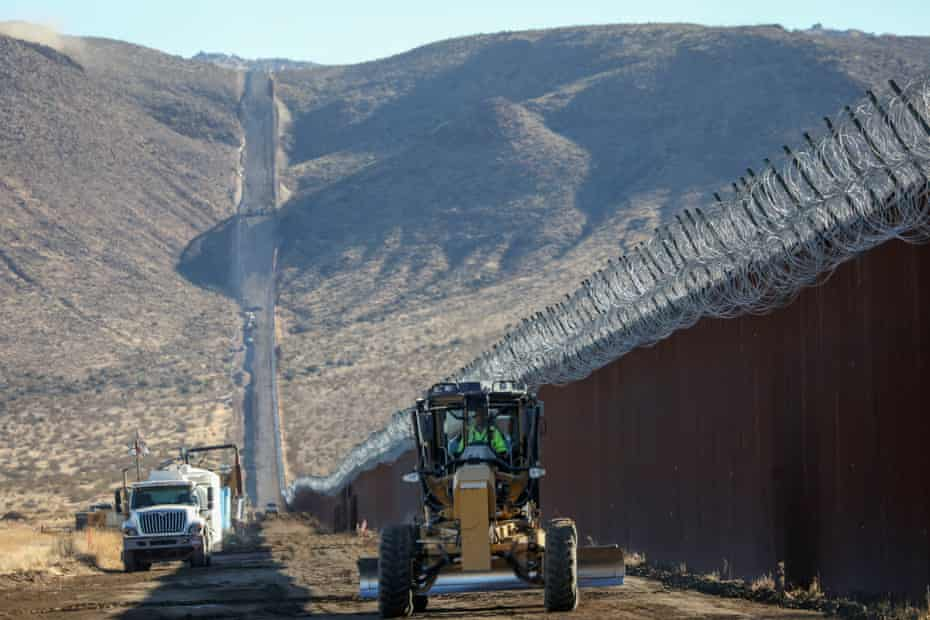Construction crews work on the US-Mexico border wall in Jacumba, California,  1 December, 2020