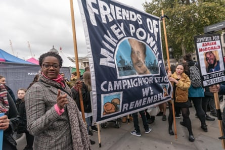 A banner commemorating Mikey Powell, at a 2018 march of remembrance for people killed in custody.