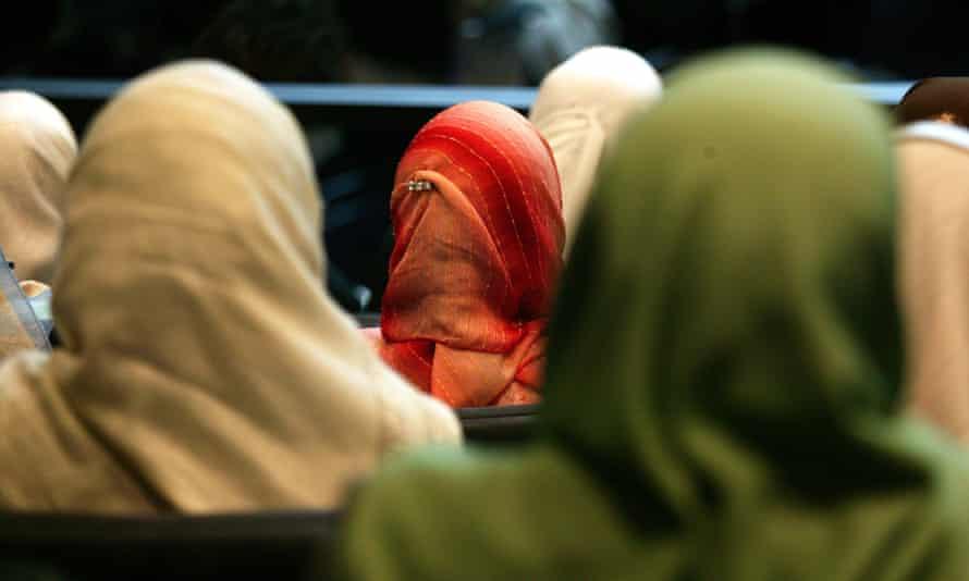 Women wearing headscarves.
