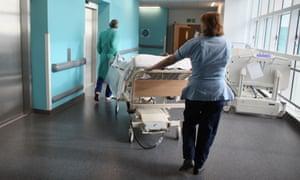 A patient is taken to the operating theatre in Birmingham Queen Elizabeth hospital