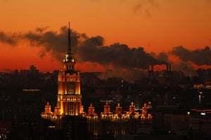 The sun rises behind the Radisson Collection Hotel building, one of seven Stalinist skyscrapers in the Moscow