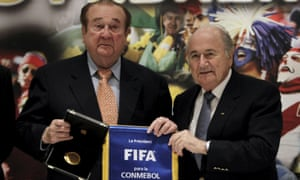 Fifa president Sepp Blatter, right, with one of those charged, the Conmebol president, Nicolas Leoz, in February 2012.