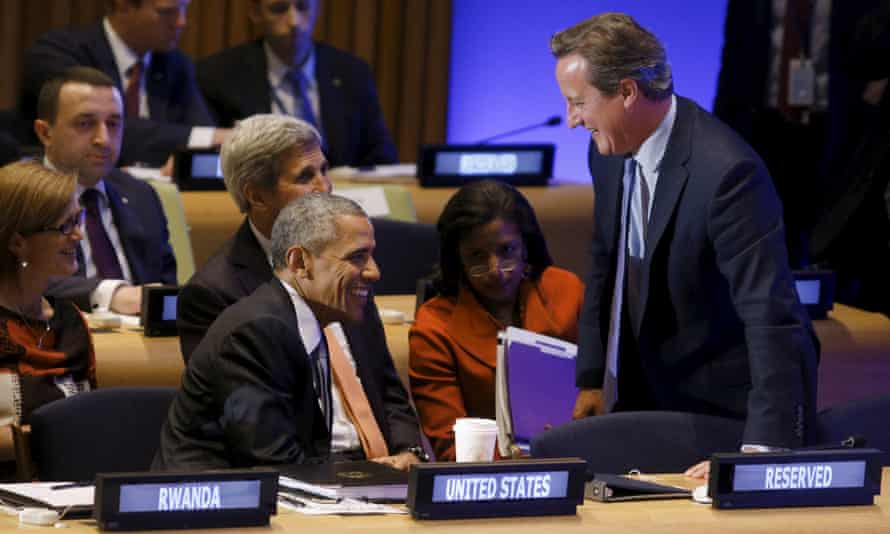 Barack Obama and David Cameron share a joke at the peacekeeper summit at the United Nations general assembly in New York.