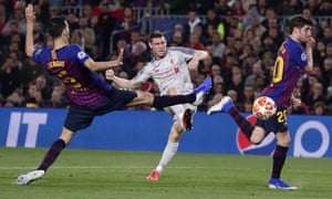 Liverpool's James Milner shoots pas, Barcelona's Sergio Busquets, left, and Sergi Roberto, right but he is thwarted by Marc-Andre ter Stegen.