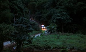 An ambulance believed to be carrying one of rescued schoolboys leaves the Tham Luang cave complex.