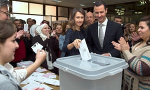 Asma al-Assad voting with husband Bashar at a polling station in Damascus in April 2016