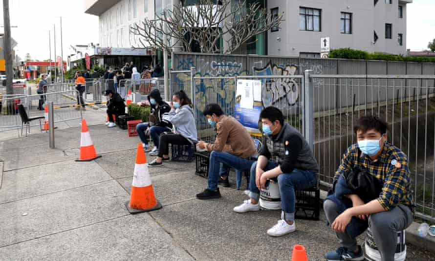 People line up at a pop-up Covid vaccination clinic at the Lebanese Muslim Association in Lakemba.