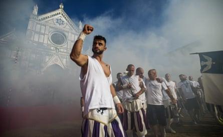 The white team of Santo Spirito enter the square for their semi-final.