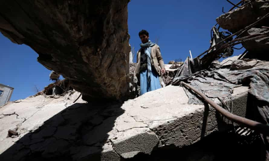 A Yemeni inspects debris of a destroyed building targeted by a previous Saudi-led airstrike on Sanaa.
