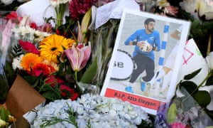 A photograph of New Zealand futsal player Atta Elayyan, victim of the Christchurch mosque attacks, sits amongst floral tributes near the Al Noor mosque.