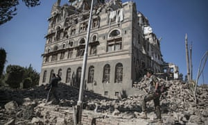 Houthi Shiite rebels inspect the rubble from Saudi-led airstrikes, in Sana'a, Yemen.
