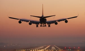 A passenger plane makes and early morning landing at Gatwick airport