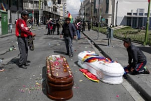 Coffins lie in the middle of a street after police launched tear gas.