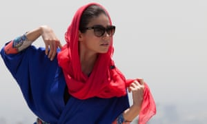 A model wearing an Iranian-style manteaux and scarf.