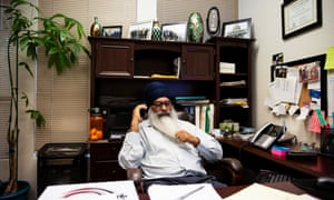 Surjit Malhi, who was the victim of a hate crime, in his office in Turlock, California.