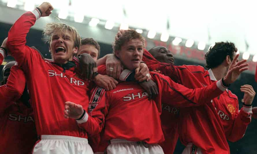 Ole Gunnar Solskjær is mobbed by Manchester United teammates after securing a dramatic victory in 1999