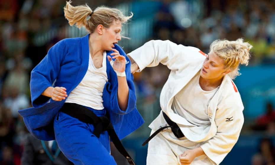 Kayla Harrison, right, used to room with Ronda Rousey before the latter turned to UFC.