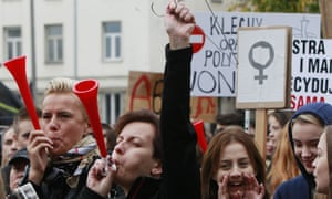 A protester raises a hanger, the symbol of illegal abortion, during the nationwide strike to protest against the proposal for a total ban on abortion in Warsaw in October last year.