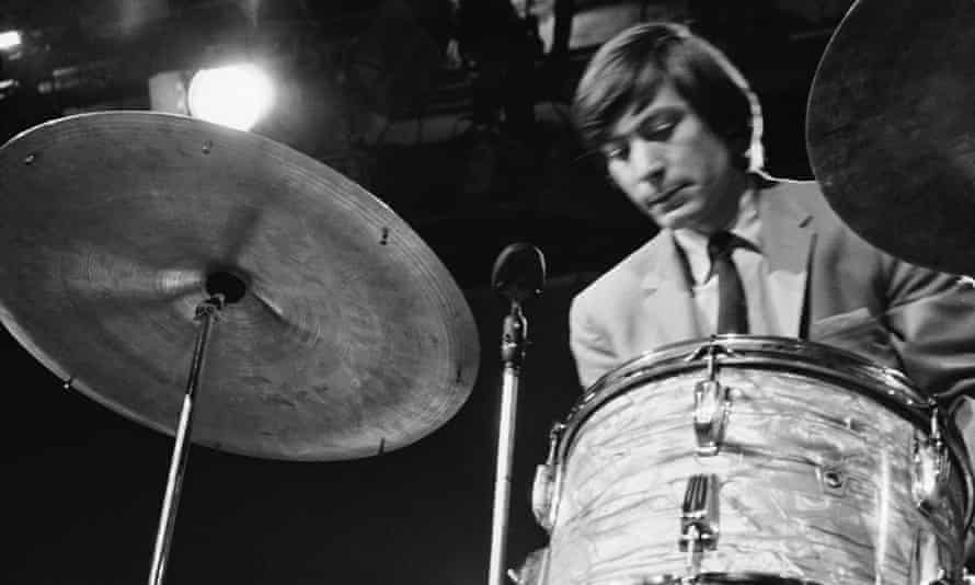 Charlie Watts in 1964. The crisp economy of his drumming, both swinging and muscular, was remarkable for its absence of frills, freeing the rest of the band to express themselves around it.