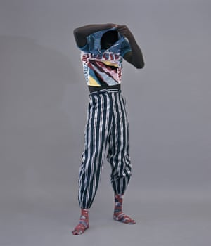 Abdou wears T-shirt and trousers, both from a selection, by Kenzo.