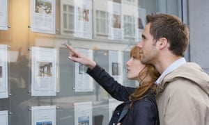 couple look at real estate