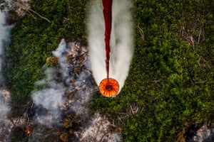 A helicopter releases water