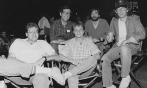 Robert Zemeckis, Bob Gale, Michael J Fox, Neil Canton, and Steven Spielberg on the set of Back to the Future.