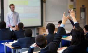 A teacher in front of a class at Pimlico Academy, London
