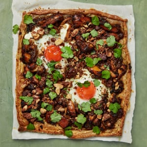 Yotam Ottolenghi's sweet and savoury chicken pie topped with eggs.
