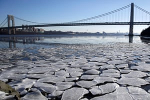 Fort Lee, NJA layer of ice is broken into pieces and floats along the banks of the Hudson River at the Palisades Interstate Park with the George Washington Bridge in the background. The northern New Jersey region continued to experience deep cold weather at the start of the new year.