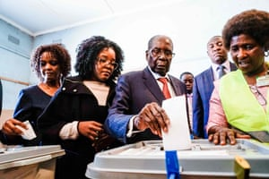 2018Robert Mugabe his daughter Bona (C) and wife Grace cast their votes at a polling station at a primary school in the Highfield district of Harare during the country's general elections