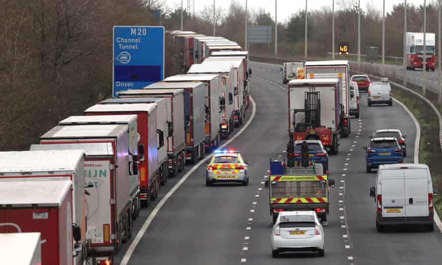 Lorries queue on the M20 to enter the Eurotunnel site in Folkestone, Kent, on Friday 18 December.