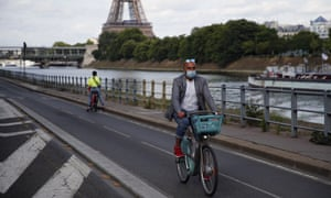 Parisians ride their bikes along the Seine river in Paris, Sunday, 24 May 2020, as France gradually lifts its lockdown.