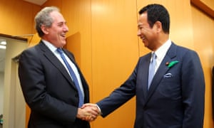 US trade representative Michael Froman shakes hands with his Japanese counterpart Akira Amari prior to their talks over TPP negotiations earlier this month.