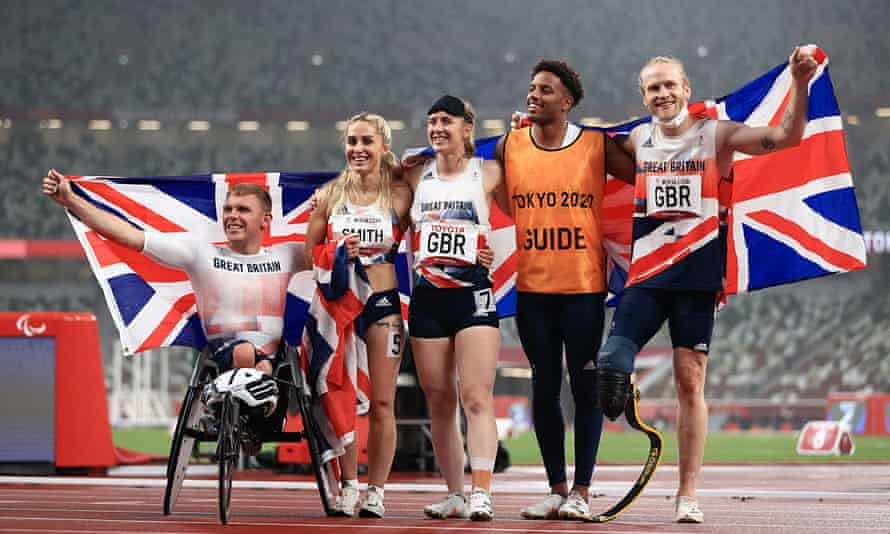 Nathan Maguire, Ali Smith, Libby Clegg, guide Chris Clarke and Jonnie Peacock celebrate their silver medal in the universal relay