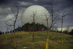 Spaceship Earth attraction at Disney Epcot in Orlando, Florida during construction in 1981. EPCOT was built by the Walt Disney company as an extension to its Magic Kingdom theme park. Contractors had just finished covering Spaceship Earth with aluminium tiles and nursery workers were still plugging trees into the landscape when Benn took his photograph.