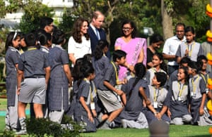 The royal couple interact with children at the memorial.