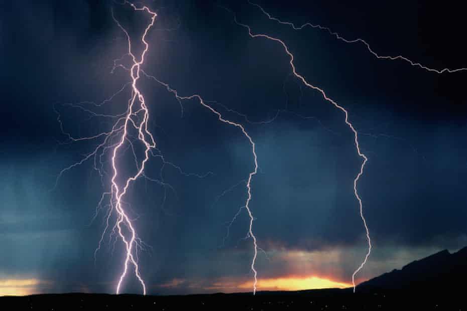 Lightning bolts on dark sky at dusk sunset Tucson, Arizona, USA.