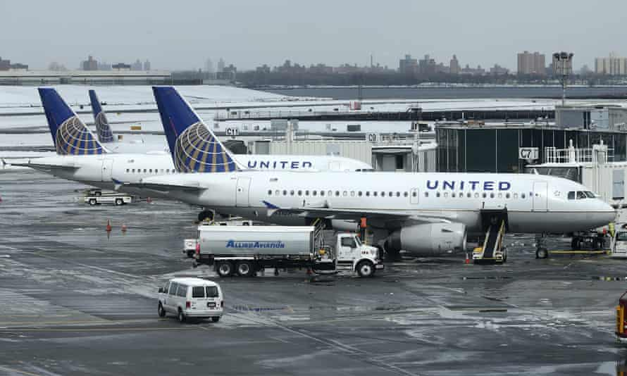 United Airlines on the tarmac at LaGuardia airport in New York. The $19 wage will be phased in by 2023. The first installment raise takes effect this November.