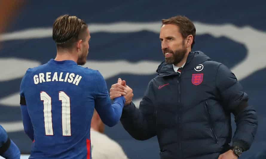 Jack Grealish shakes hands with Gareth Southgate after being substituted.