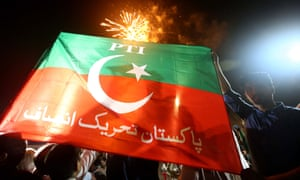 Imran Khan supporters celebrate after Khan takes his oath of his office on Saturday.