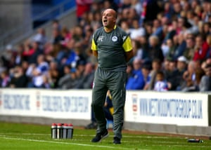 Wigan Athletic manager Paul Cook gives insturctions during a pre-season friendly against Liverpool