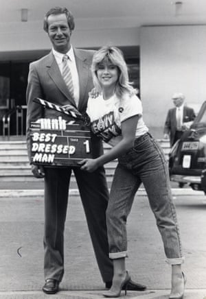 Barry Norman pictured with Samantha Fox after he was voted Britain's Best Dressed Man in 1985