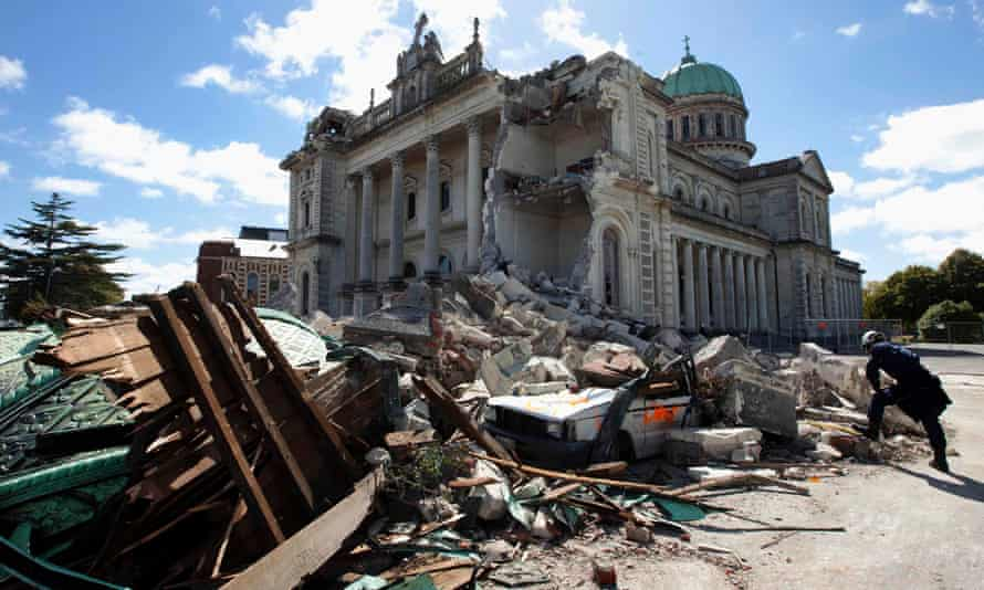 A rescue worker looks through the rubble of the Cathedral of Blessed Sacrament in Christchurch, New Zealand after the February 2011 earthquake